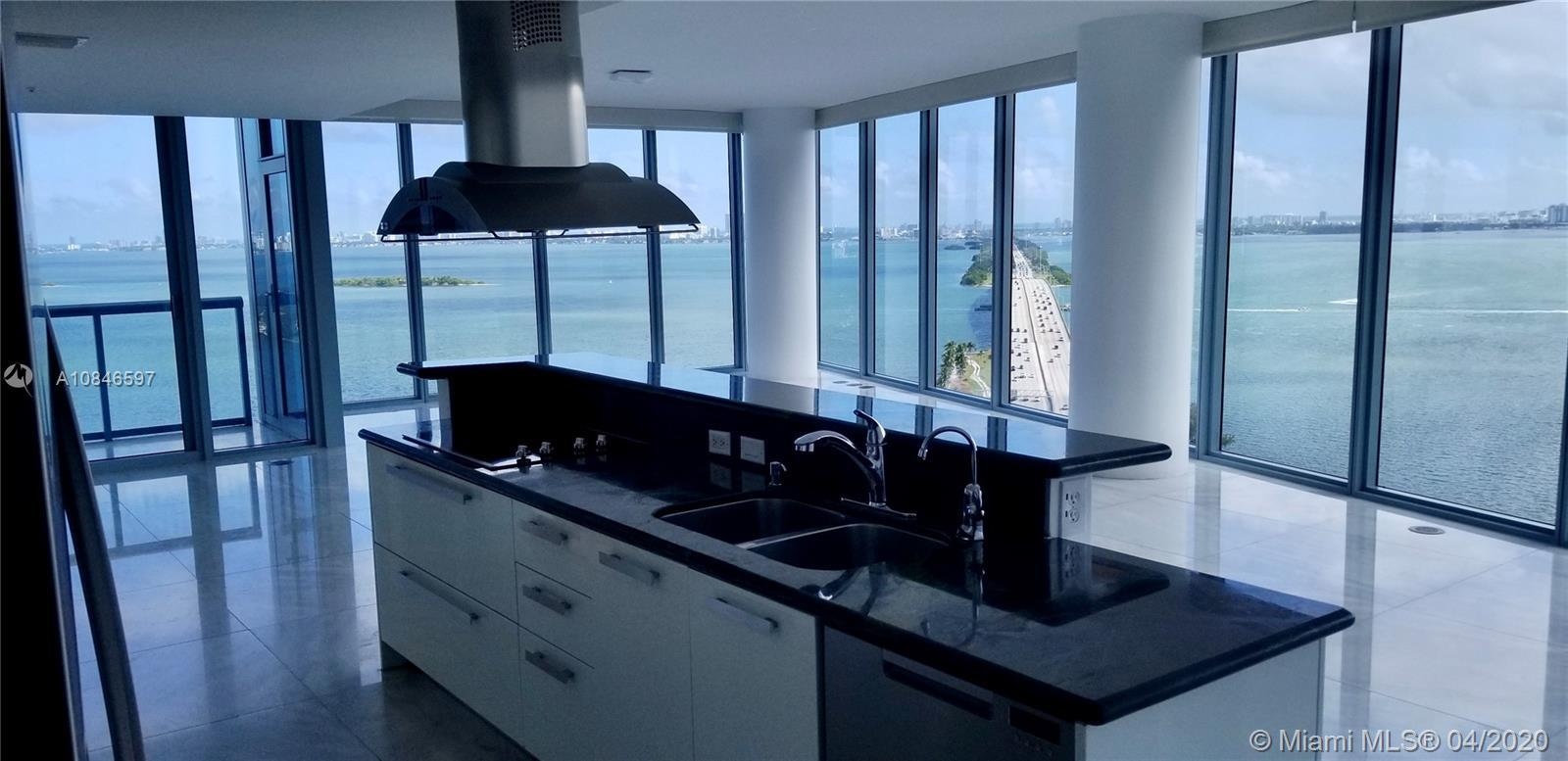 Enchanting line 12 unit w/spectacular views of Miami. Marble floors, Mahogany doors, stainless steel