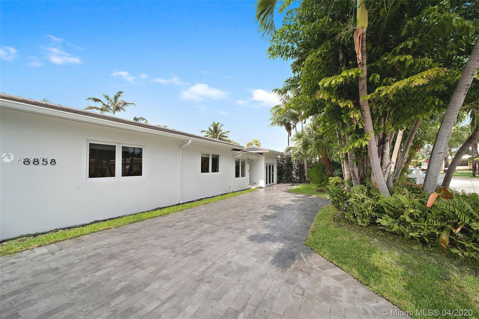 Luxurious & completely Remastered this Surfside Gem sparkles brightly on an oversized lot on a quiet