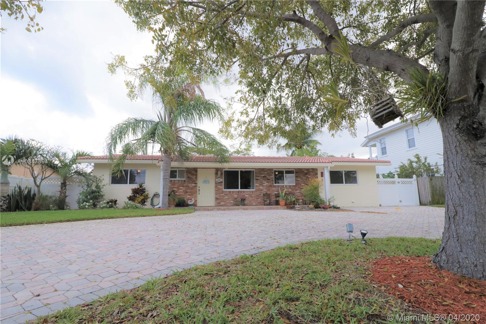 Beautifully updated traditional Florida style 3/2 Ranch home in prestigious Pompano Shores. This  t