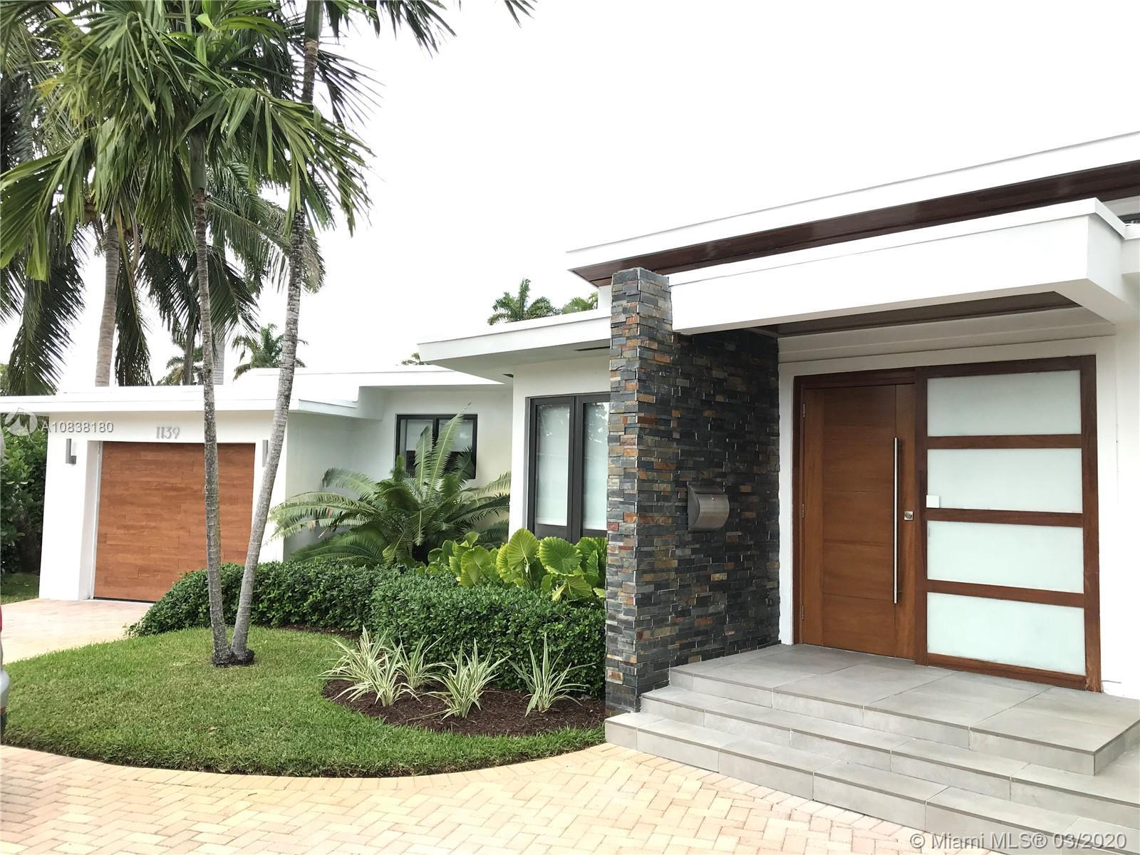 MID CENTURY MODERN GEM IN MIAMI SHORES. A luminous and spacious home with 2450 SF of total living sp