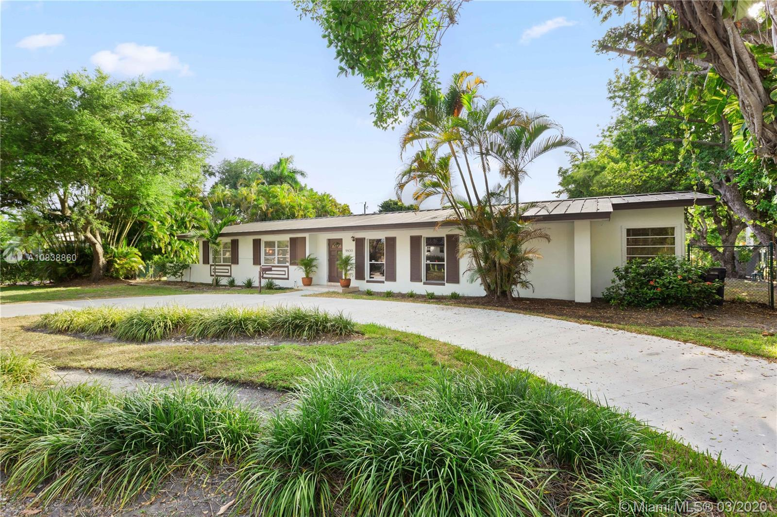 Nestled amongst the tree canopy, this 4-bedroom, 3-bath, pool home offers a feeling of seclusion in