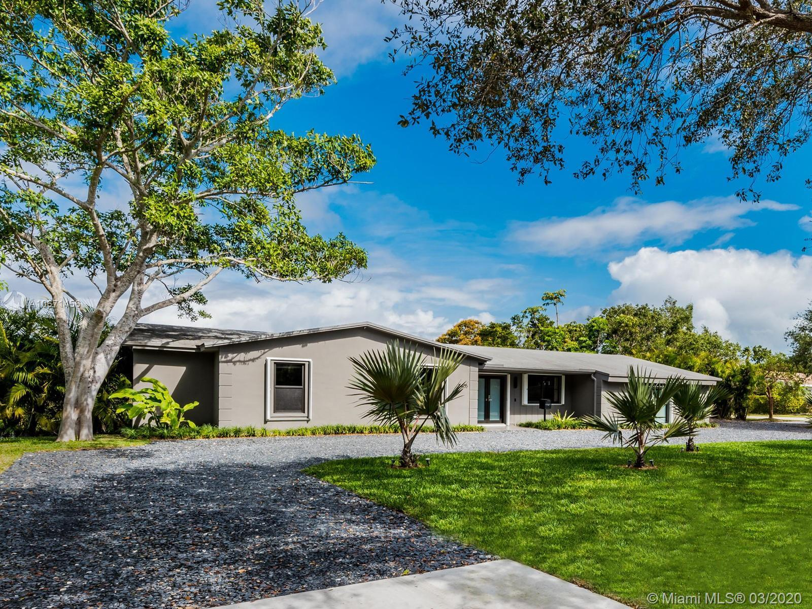 Gorgeous designer house on a 1 acre lot in one of the best school areas in Pinecrest. The house is c