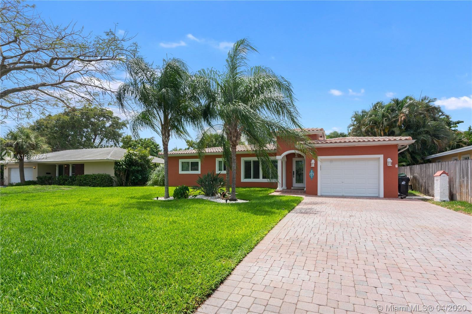 TRADITIONAL ISLAND STYLE TRANSLATES TO CASUALLY ELEGANT SOUTH FLORIDA LIVING IN THIS CORAL SHORES HO