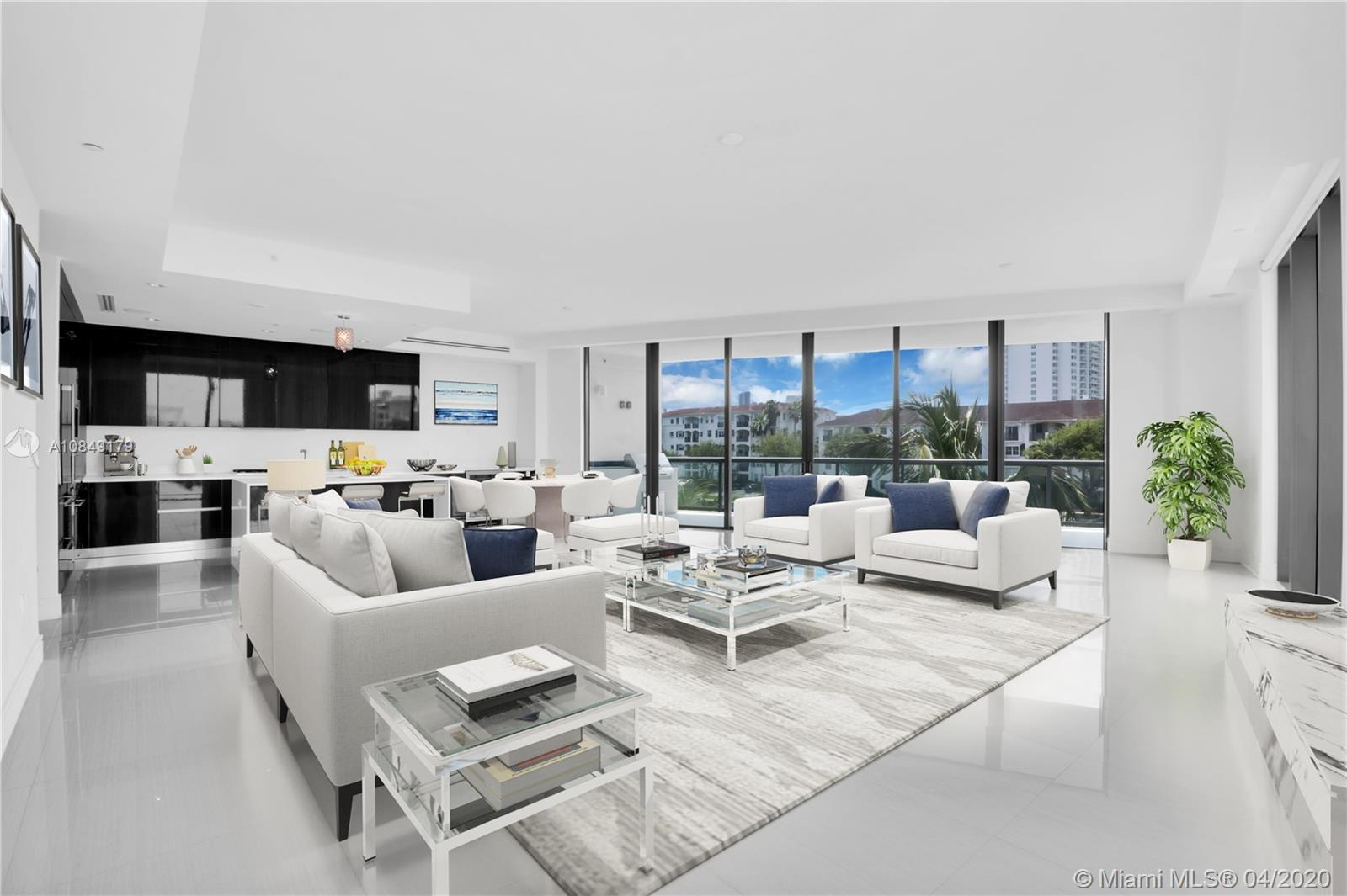 Located seconds from Aventura Town Center, Aventura Mall, Founders Park, and beaches this modern flo