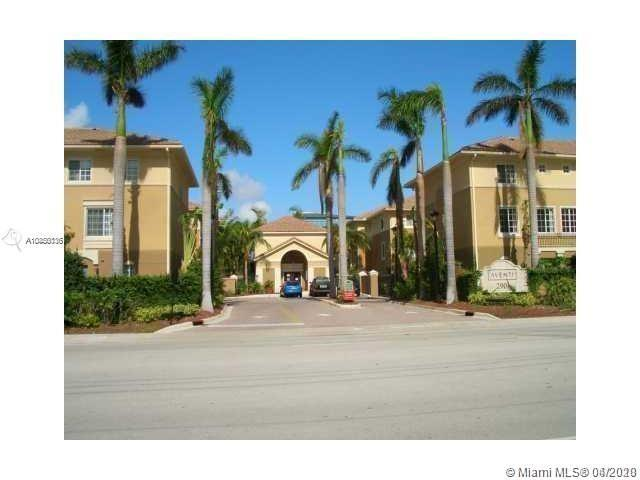 SPECTACULAR TRI-LEVEL TOWNHOUSE WITH A COVERED PRIVATE GARAGE ON FIRST FLOOR.  AUTOMATIC REMOTE DOOR