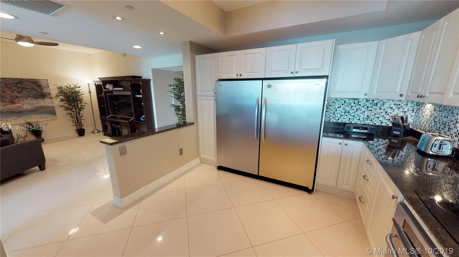 Beautiful remodeled condo is one of the best in Aventura Marina II.  The expanded gourmet kitchen ha