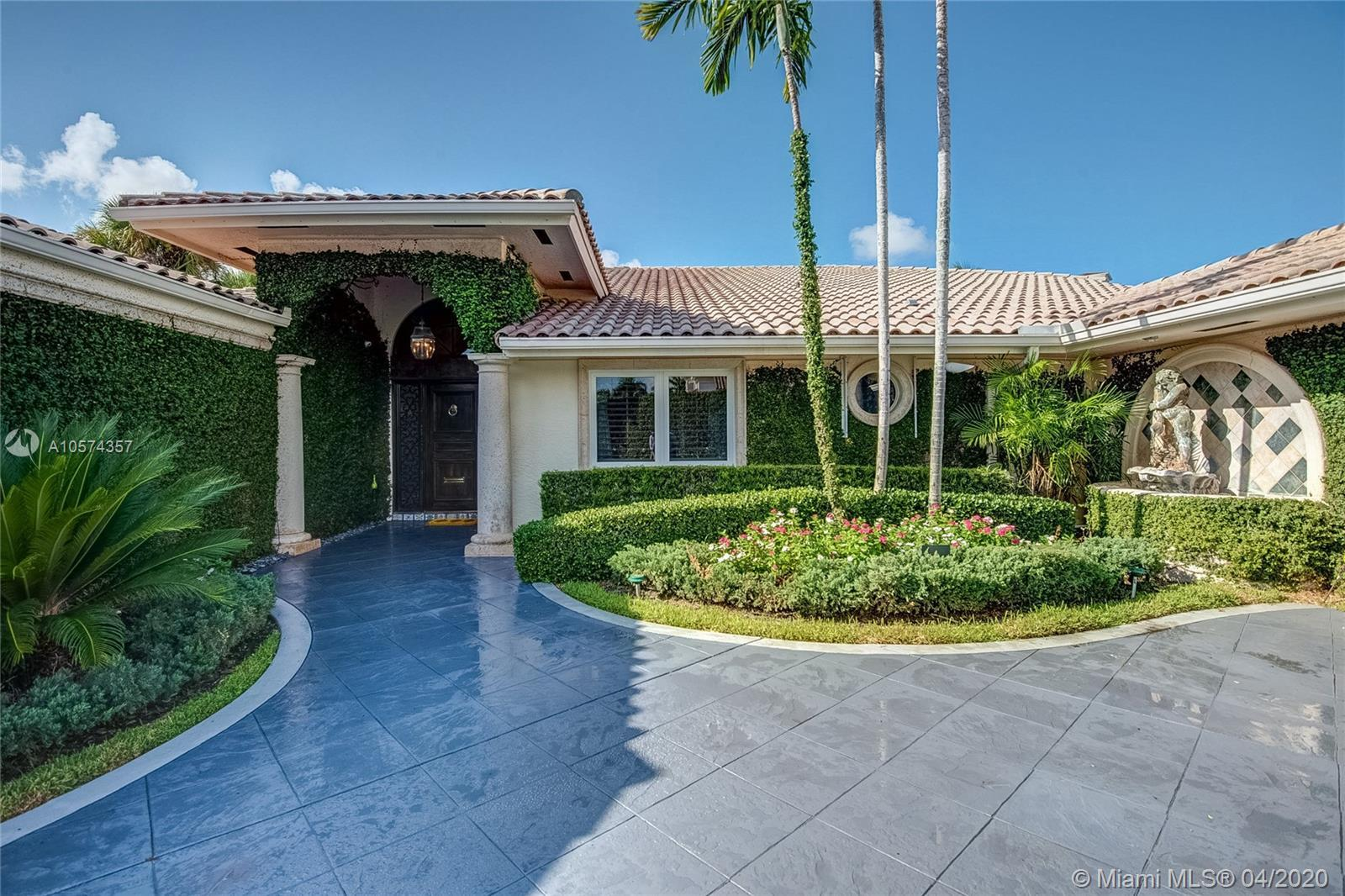 Stunning single story residence directly on the golf course in Royal Palm Yacht & Country Club. This