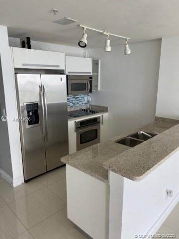 MINT CONDITION, MODERN + BEAUTIFUL UNIT ON HIGH FLOOR (28 OUT OF 35). LARGE RECESSED/COVERED BALCONY