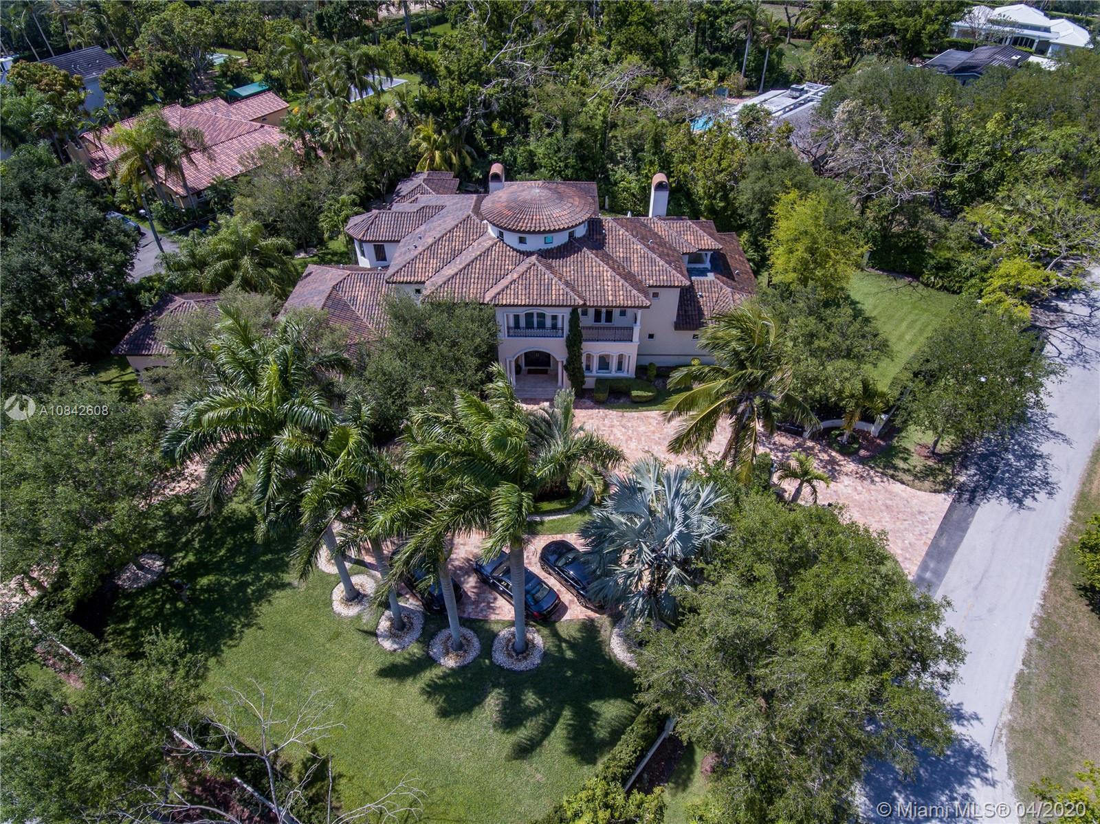 A Must See! Entertain family and friends in the spectacular corner builders acre estate residence in