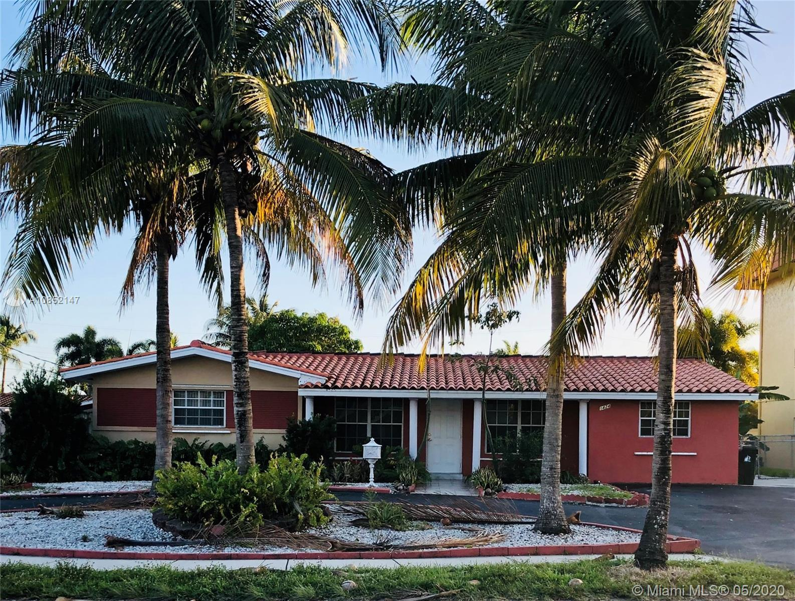 Spacious family home in the heart of Coral Ridge Isles. Features include large open living space wit