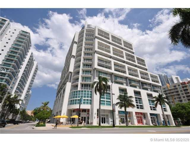 South Florida Riches Real Estate Presents a 2/2 in City 24. Unit has 13 foot ceilings, pergo wood an