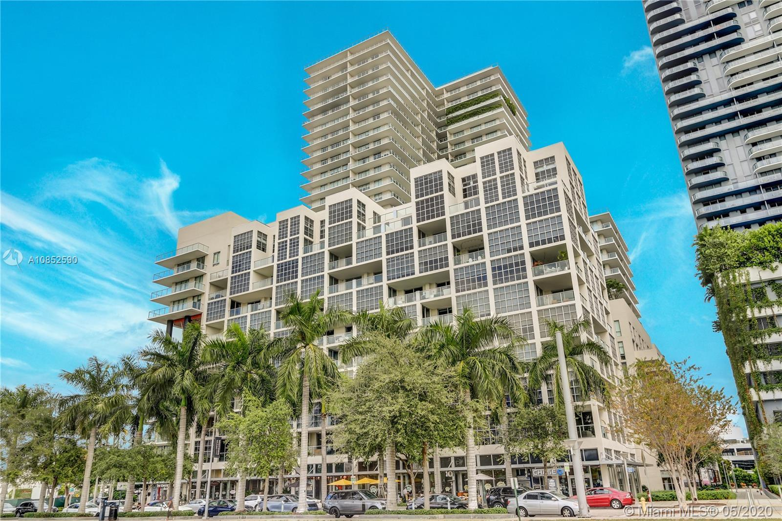 LIVE, WORK & PLAY in Midtown Miami! This 3 story townhouse-style condo features a ground floor Stree