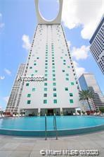Awesome unit 2 bed 2 bath (double masters) with amazing views of bay and Miami river, wood floors with marble and ceramic in bathrooms, Stainless appliances, 42nd rooftop pool, and sundeck. 11th floor pool and pool side cabanas, concierge 24/7, valet parking, spa, gym, with 24/7 security in lobby area. Walking distance to metro mover, Brickell center, Downtown, Arena and performing arts. Minimum lease allowed 30 days. Owner finance with 50% down.