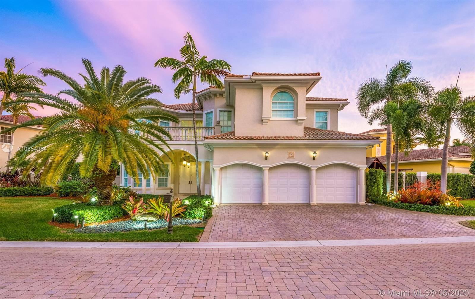 Move right into this perfectly situated sanctuary in one of the most desirable gated communities in