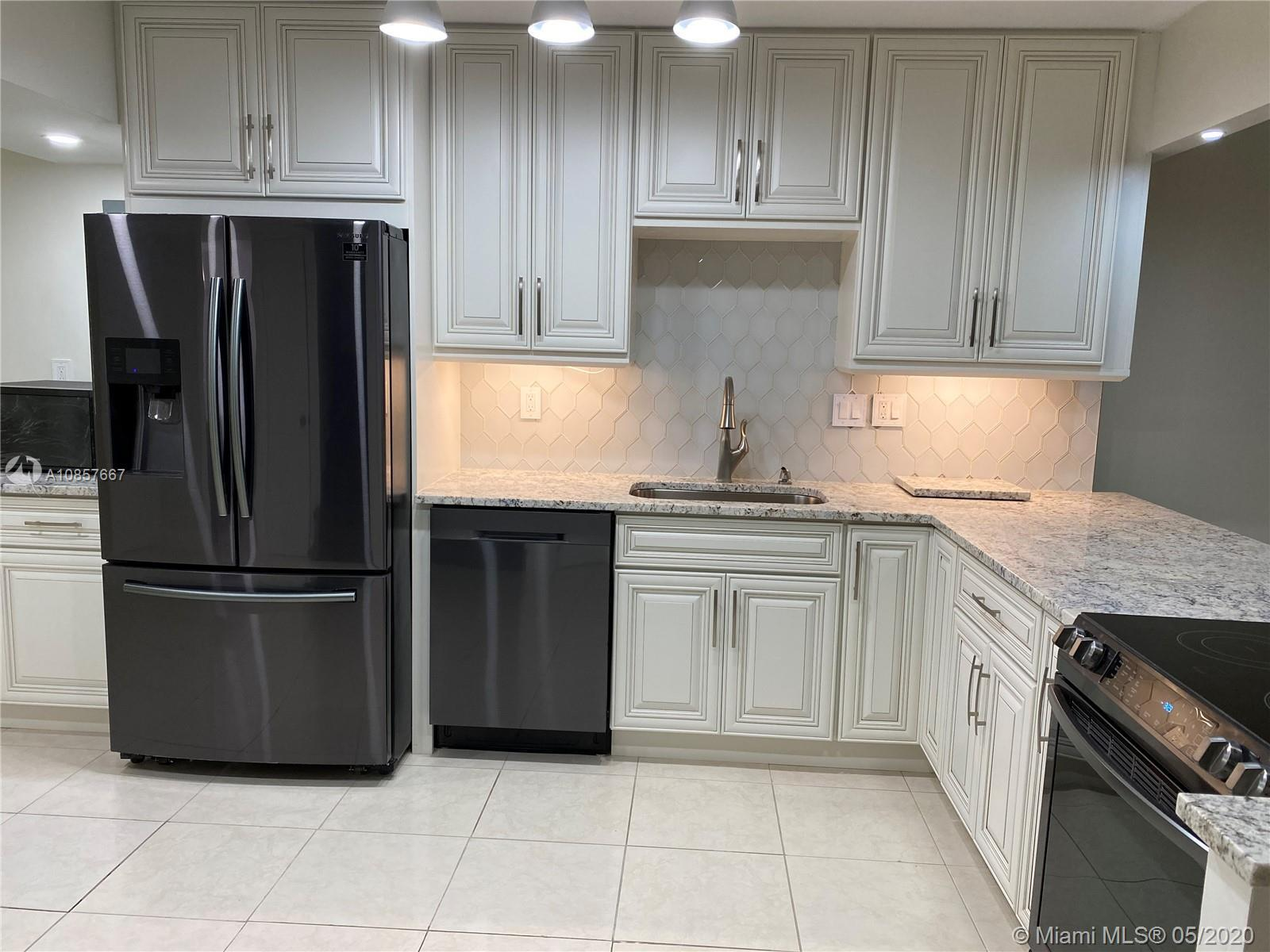 Beautifully renovated 3-bedroom, 2.5-bathroom townhouse in the heart of Aventura. Brand new kitchen