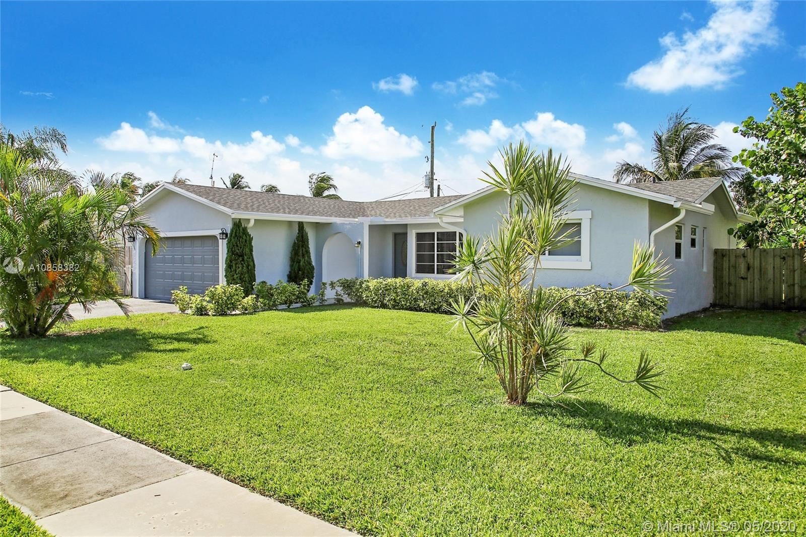 Beautiful East Boca Tastefully Remodeled Single family home with NO HOA! Spacious 2-bedroom plus den