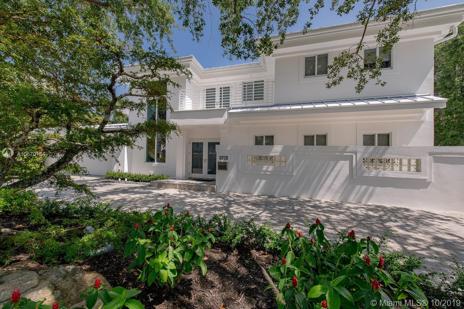 Contemporary waterfront home in the island community of Sunrise Key w/ gated automatic entry & secur