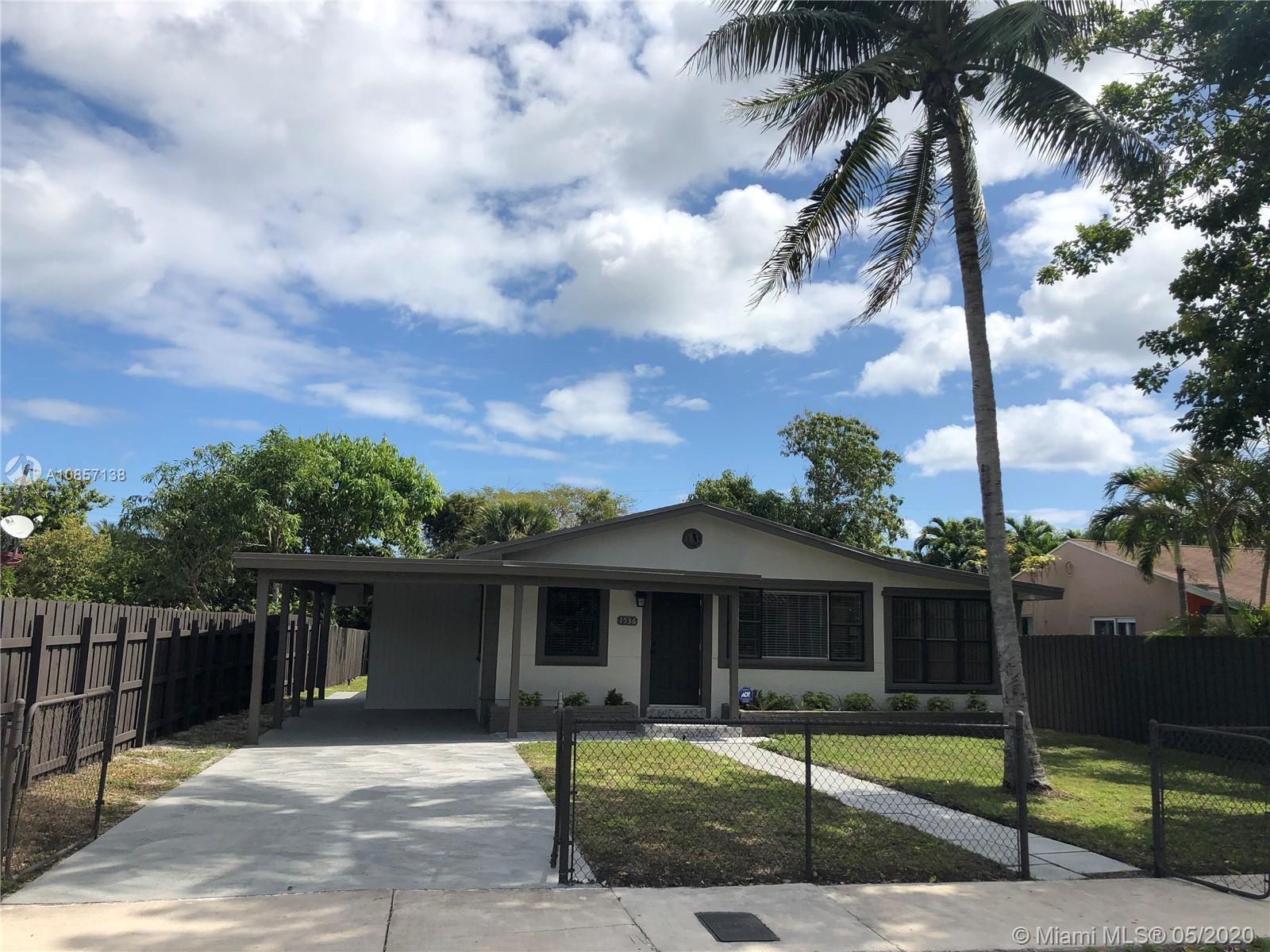 Beautiful remodeled 3 bed / 2 bath home with cover carport & separated Utility Room /laundry rooms ,