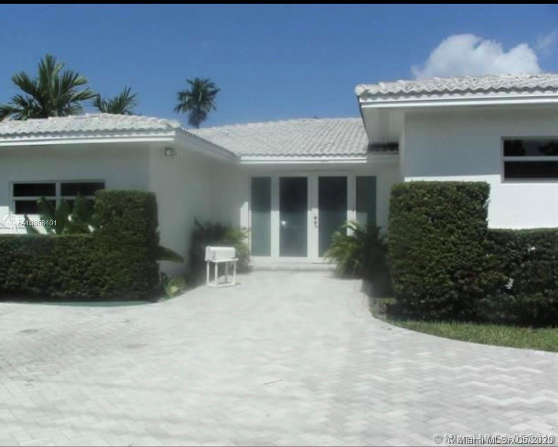 Waterfront gated Biscayne Point Island Miami Beach home with rare boat inlet, impact windows, no fix