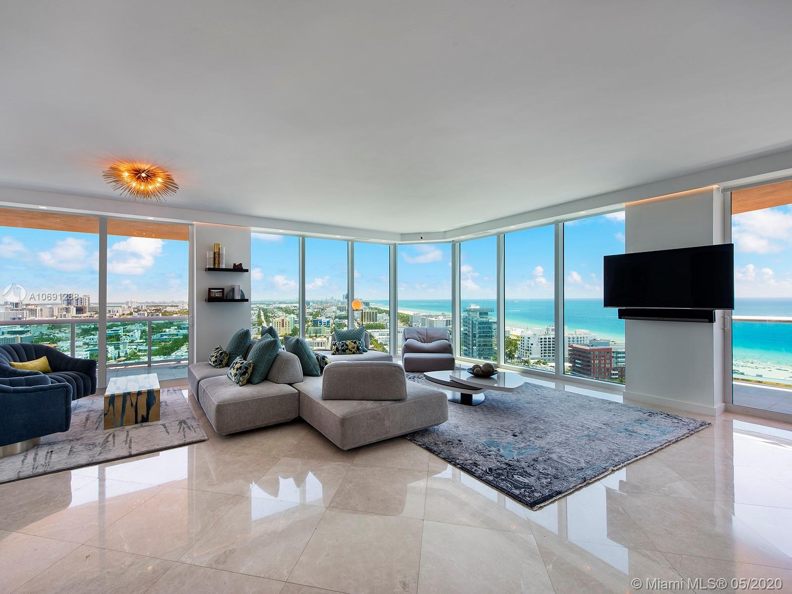 Fully renovated, this gorgeous 3-bed, 2.5-bath corner unit features an expansive floorplan with brea