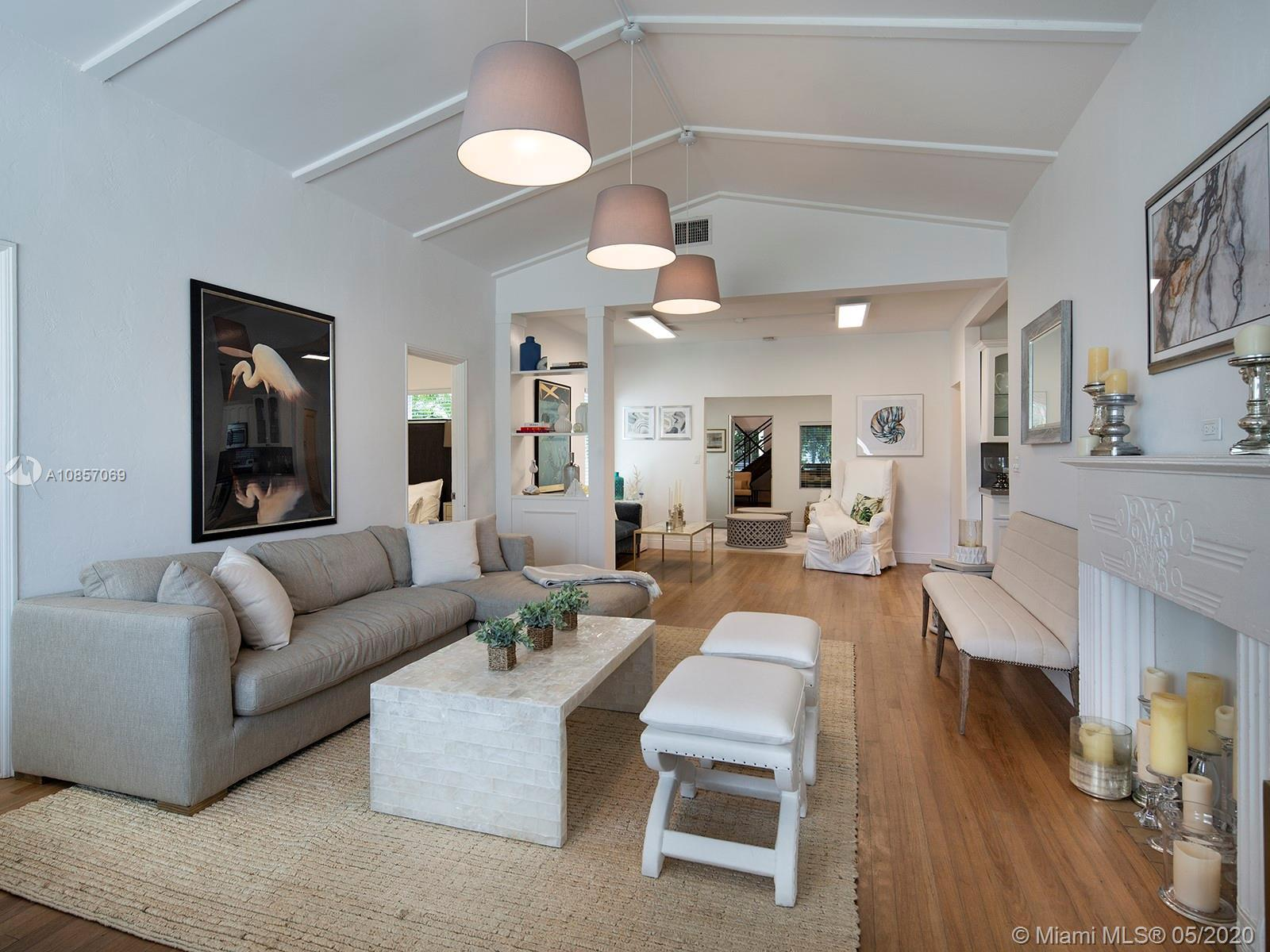 Step inside this sunny south beach home on Flamingo Way! Tastefully renovated, this single family ho
