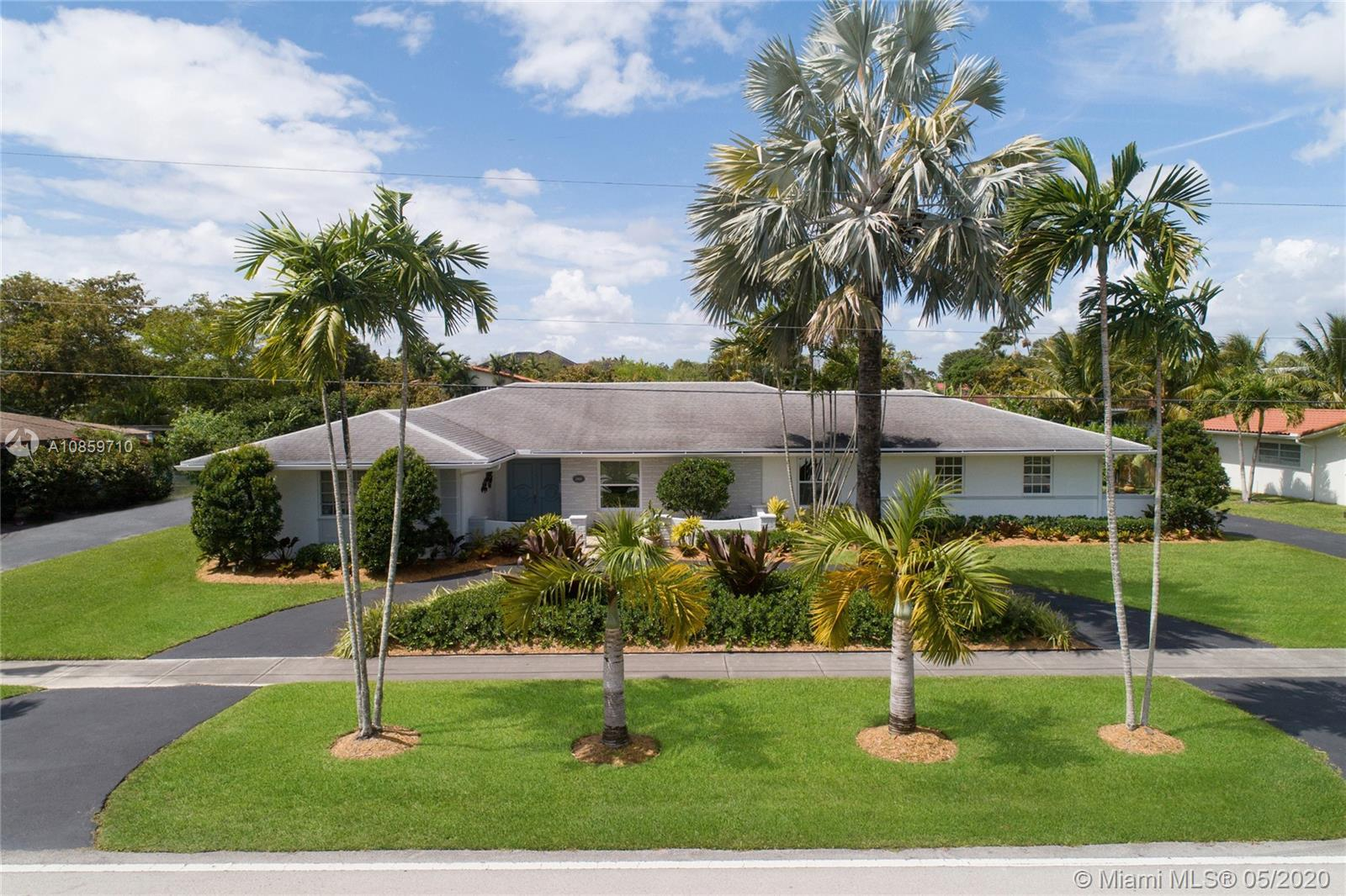 Pinecrest dream home on a peaceful canal. Beautifully renovated by residential designer Cyndi Navarr