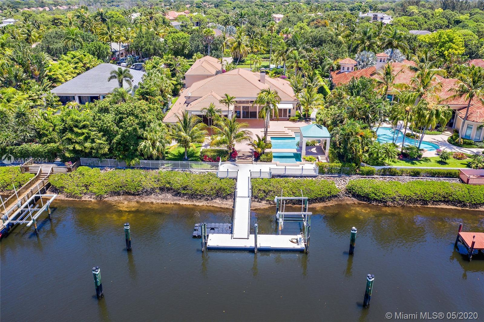 Vacant and Easy to Show! This custom home has a Rare Social Membership in Admirals Cove. The larger