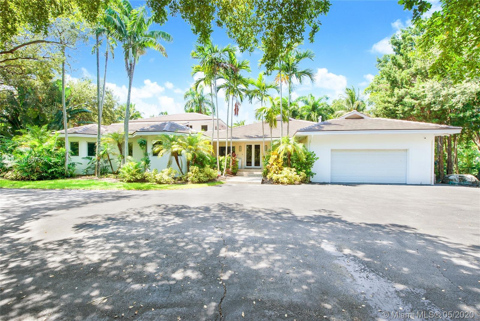 Exclusive Gables by the Sea Single Story Estate nested on a 2 acre lushly landscaped lot. Completely