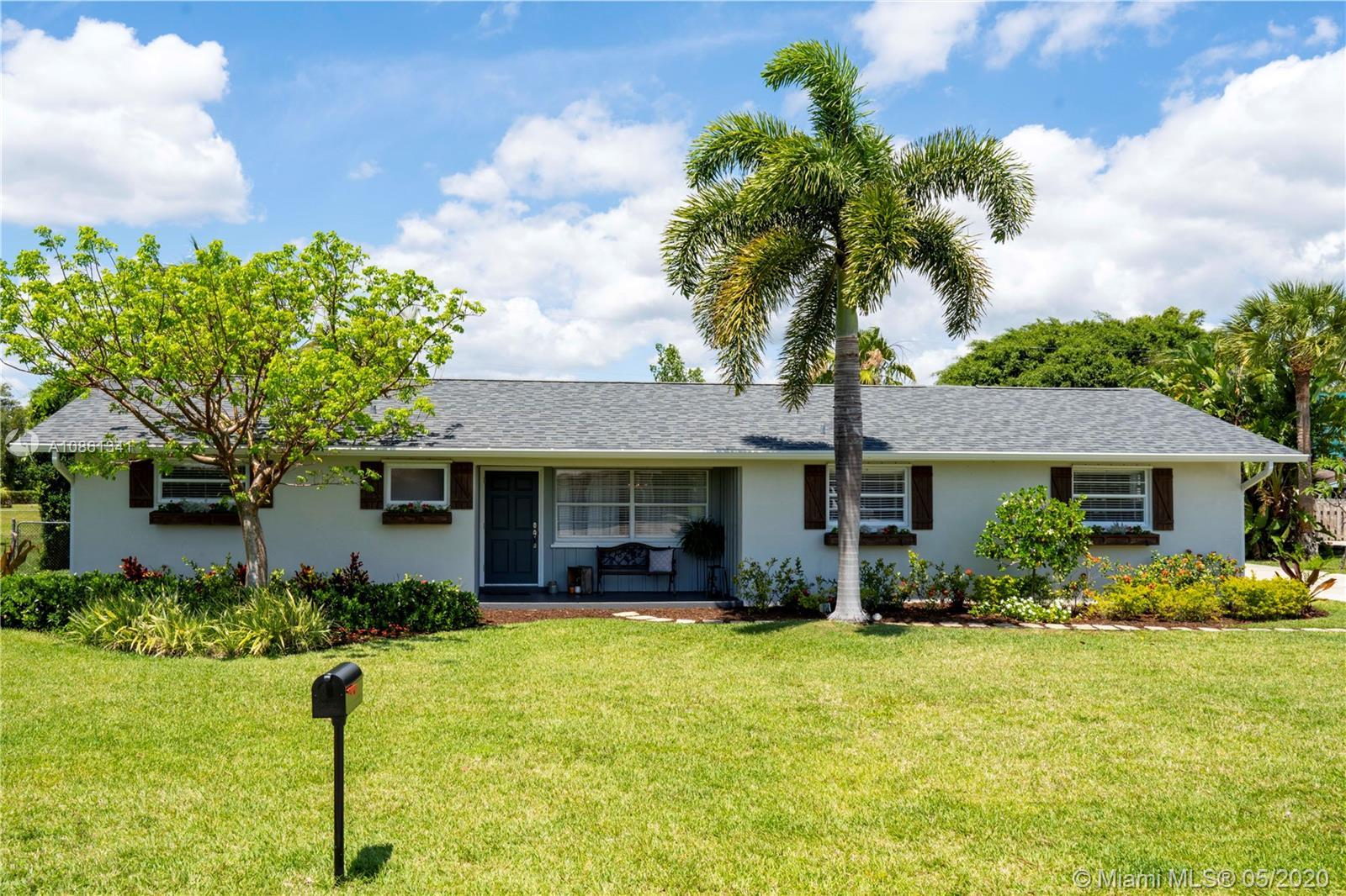 Beautifully remodeled home in great family neighborhood. Surrounded by waterfront homes. Walk to Jup