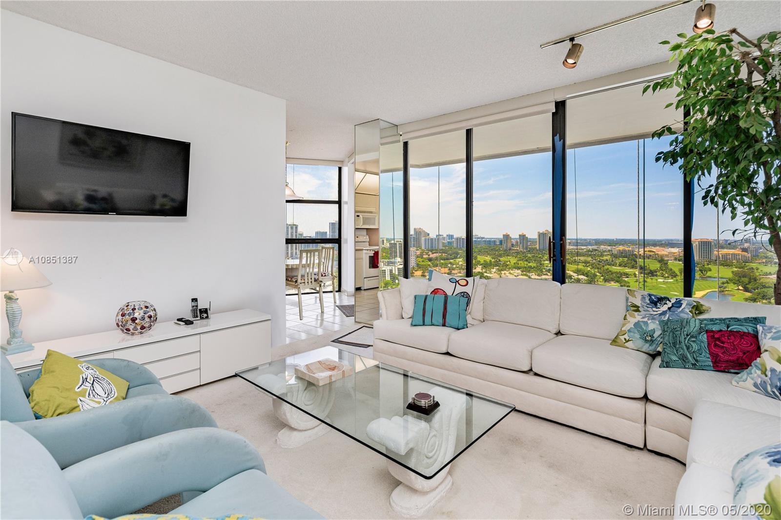 Lowest price in the building + High Floor! Most beautiful panoramic views of the golf course, lake &