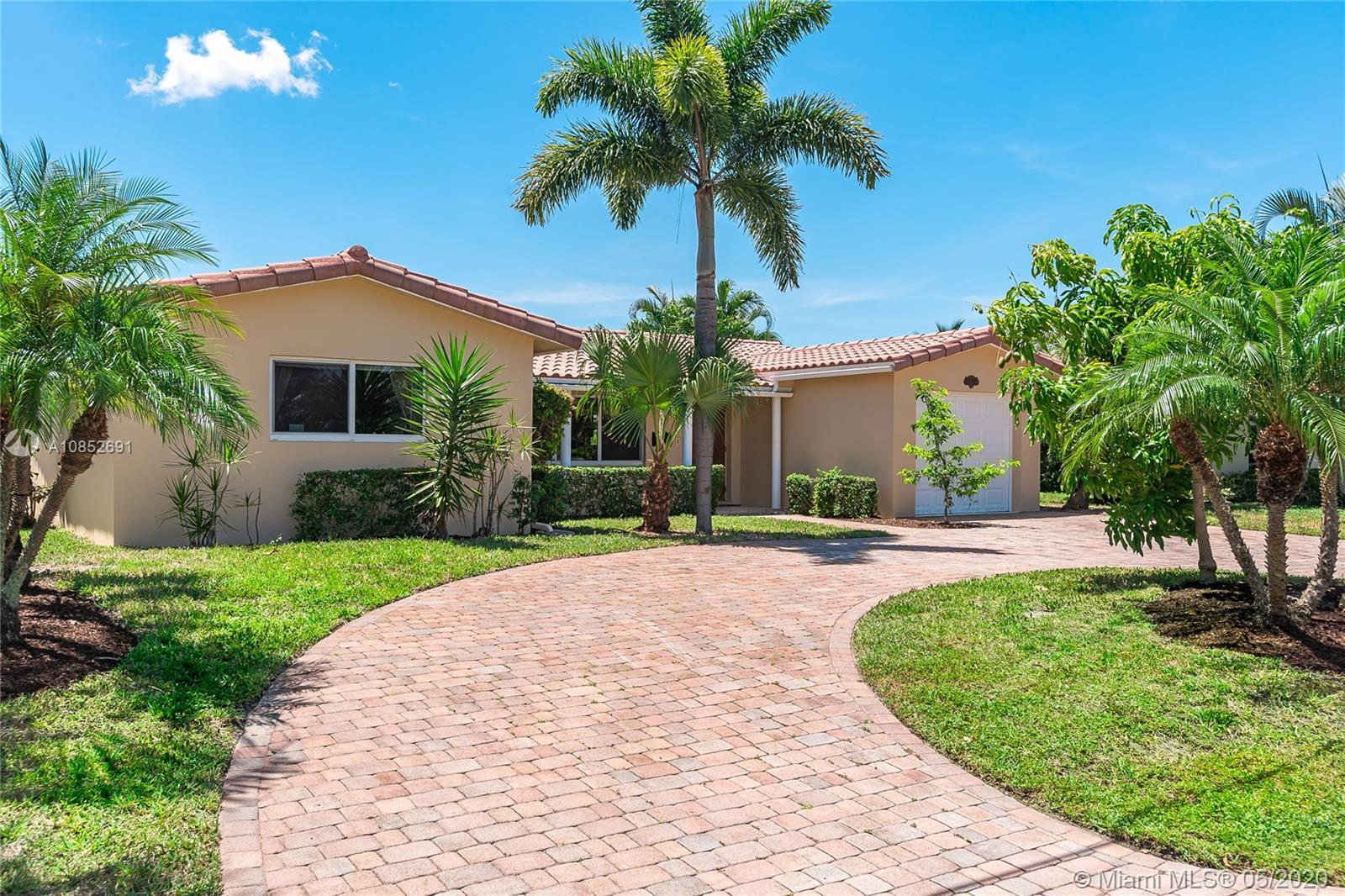Turnkey waterfront 3/2 home in desirable Coral Ridge Isles w/ ocean access.  Bonus room for 4th bedr