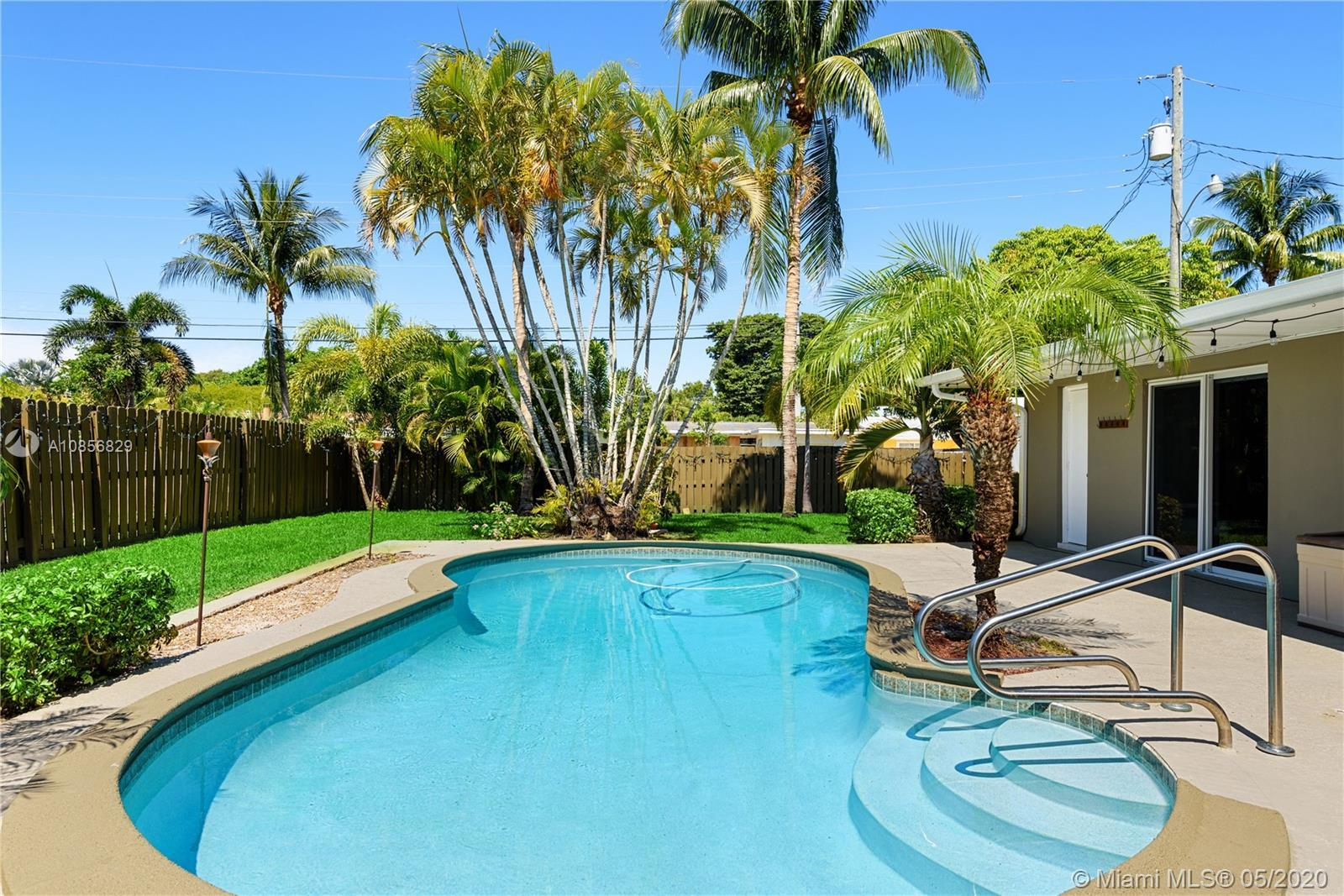 This GORGEOUS, completely remodeled pool home features all hurricane impact doors & windows, spectac