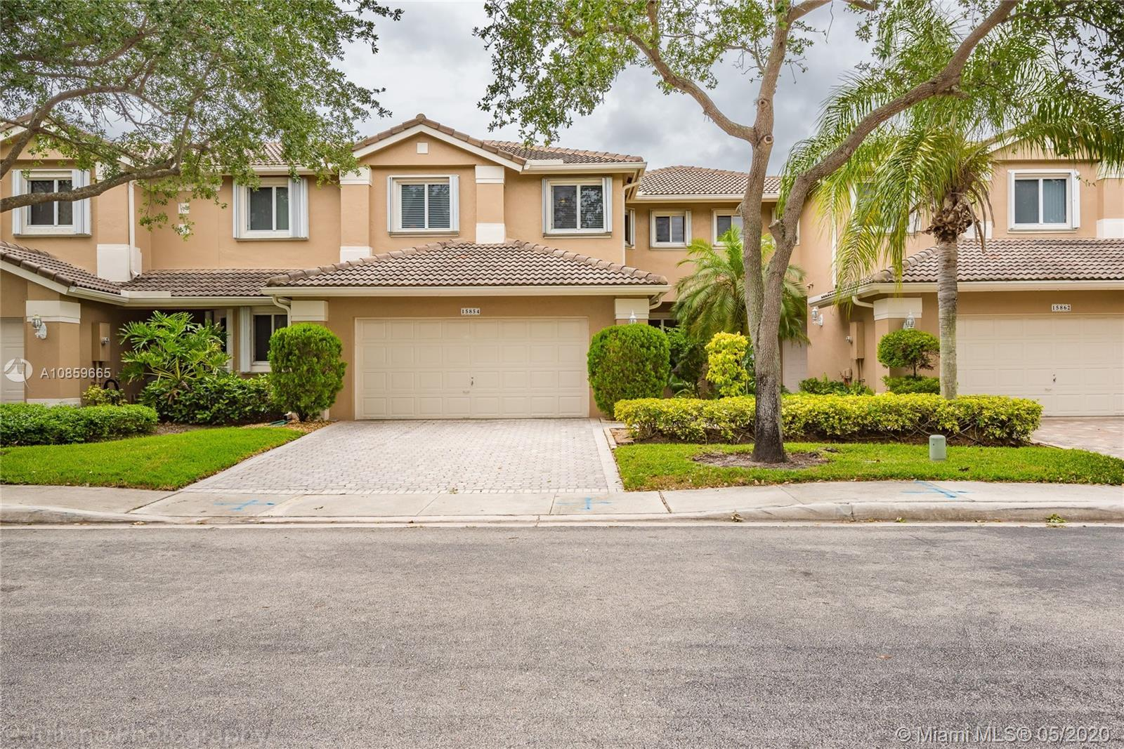 DECORATOR'S DELIGHT!!! IMPECCABLE SPACIOUS TOWNHOME IN OPTIMAL CONDITION. LOCATED IN DESIRABLE GATED