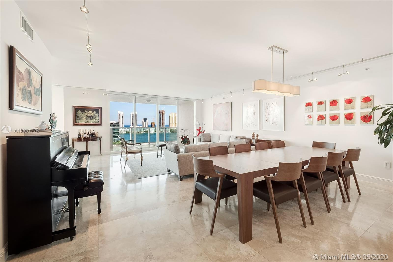 Enjoy the best views of Aventura in the exclusive northeast corner at the Peninsula. This flow-throu