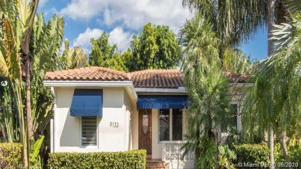 Exquisitely remodeled modern family home in the sought after Surfside neighborhood. This 3BD/2.5BA +