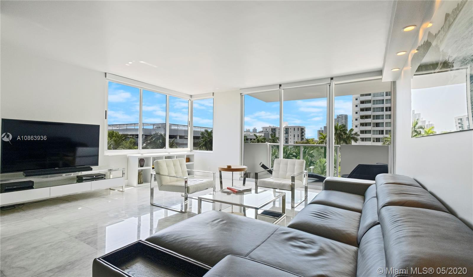 Perfect unit if you value high-end finishes, location and space. Large & bright corner unit at the M