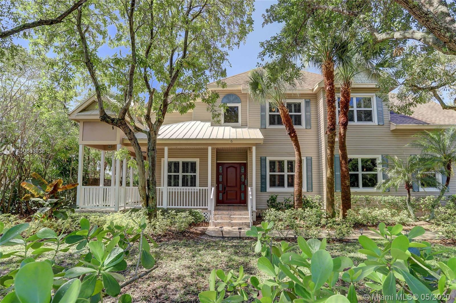 This gorgeous Corner Lot, updated Victorian / Key West style, thoughtfully updated w/ wide plank eng