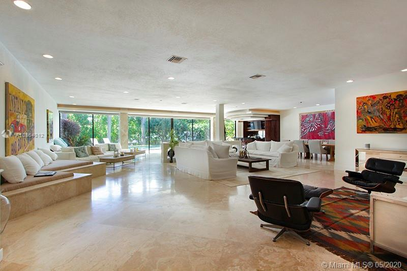 Located on a prestigious, gated Sunset Islands III. Just a stroll away from Lincoln Road, Sunset Har