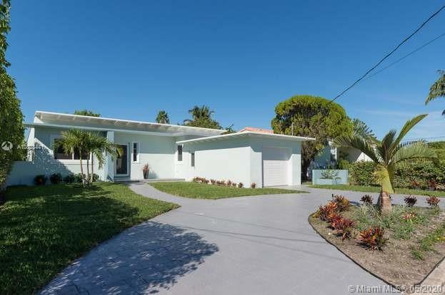 10 minutes to South Beach, 4 bedroom 3 bath + 1 Car Garage, Renovated, Walk to the Beach, A+ Schools