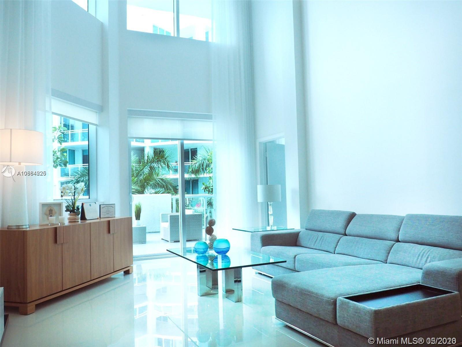 Gorgeous Modern 2400 Sqft - 3 / 2.5 Loft in a chic boutique building in the heart of Aventura. Spaci