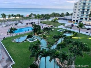 Beautiful Ocean views from this updated Beach front Condo tastefully converted to two bedrooms. The