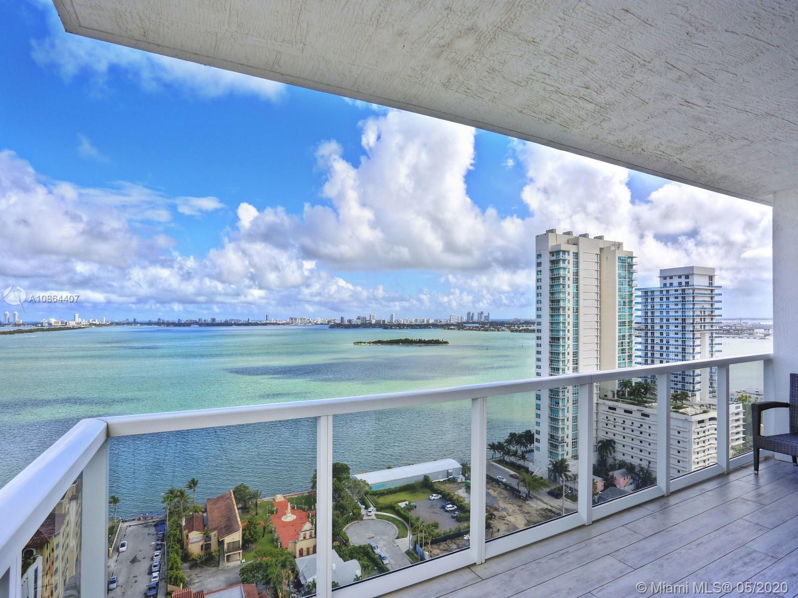 This 22nd floor residence of Bay House, located in Edgewater East, offers stunning, wrap-around view