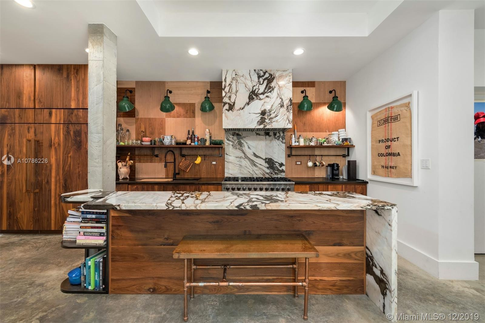 One of a kind fully renovated modern townhome meticulously redesigned feat. 12 FT ceilings, private