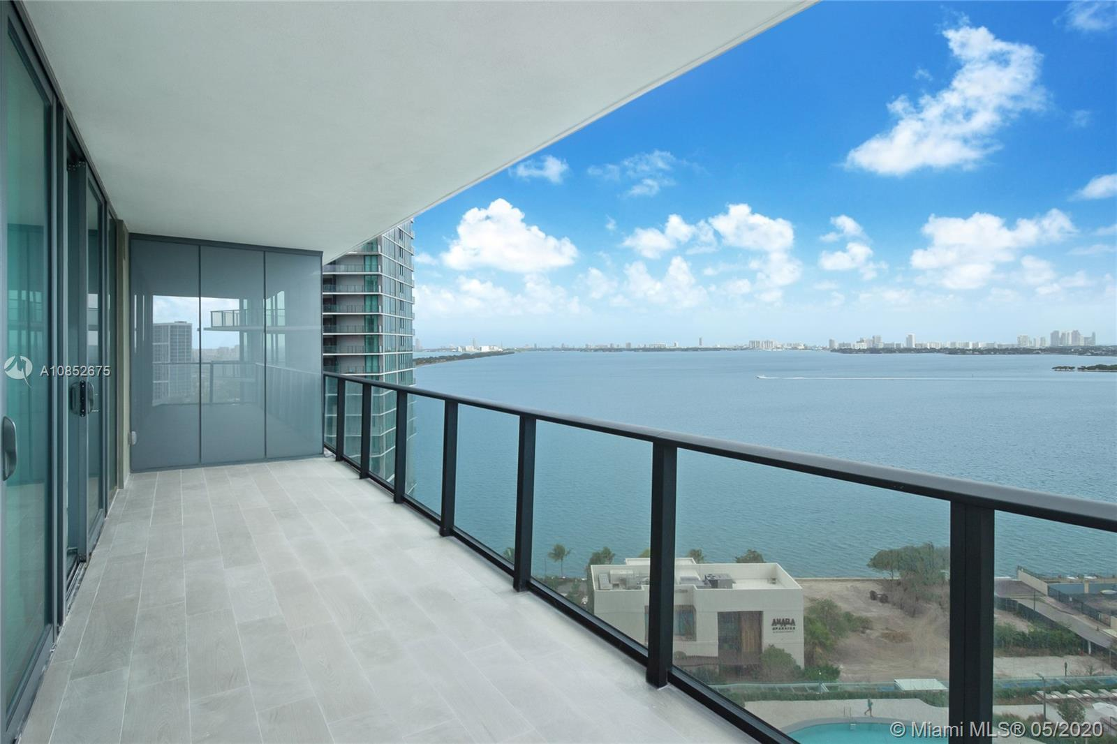 $60,000 worth of flooring installed! A stunning condo with stunning views in a stunning building! Wo