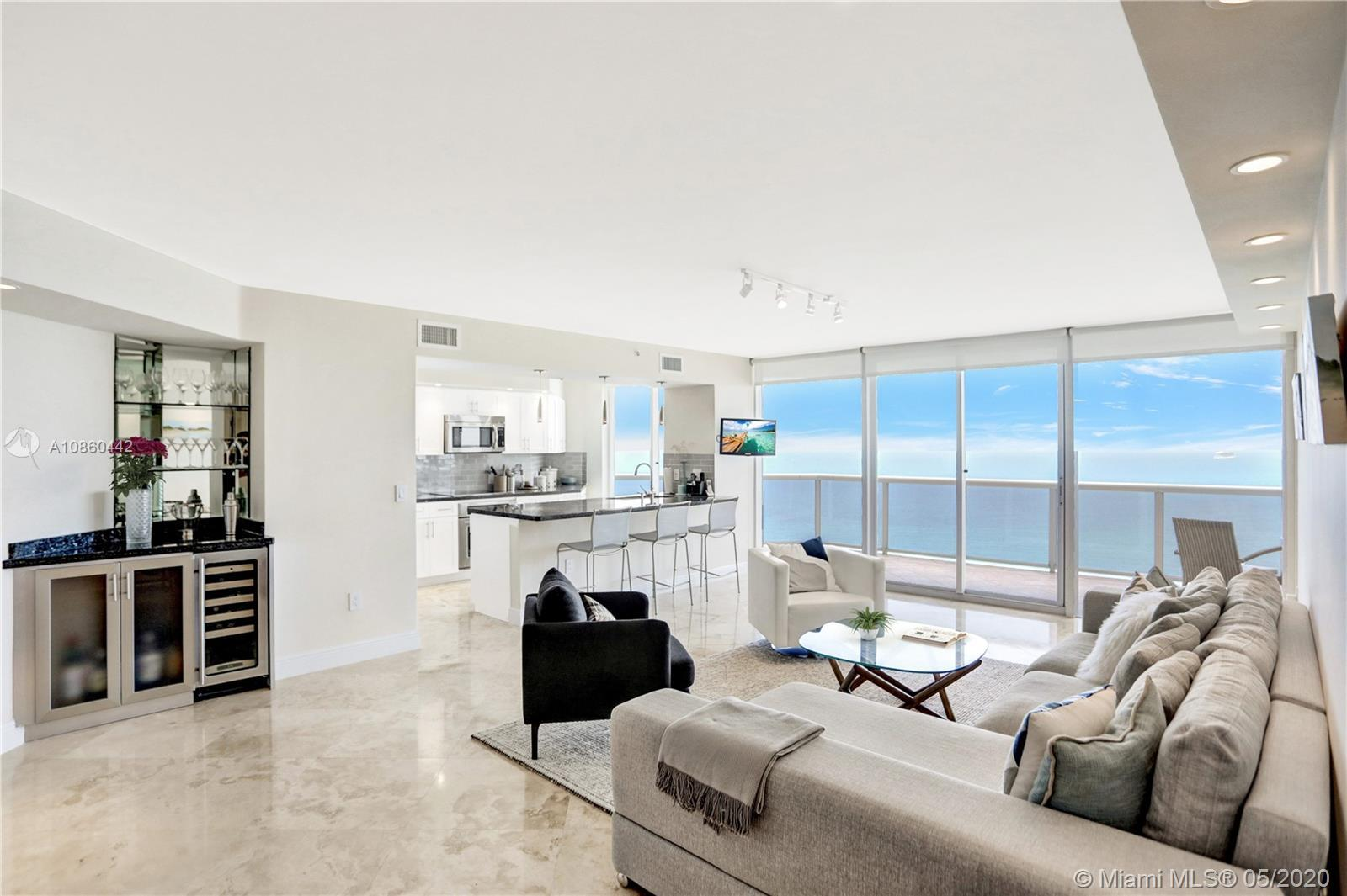 Unbelievable high floor direct SE views of the ocean, downtown Miami skyline, and miles of white bea