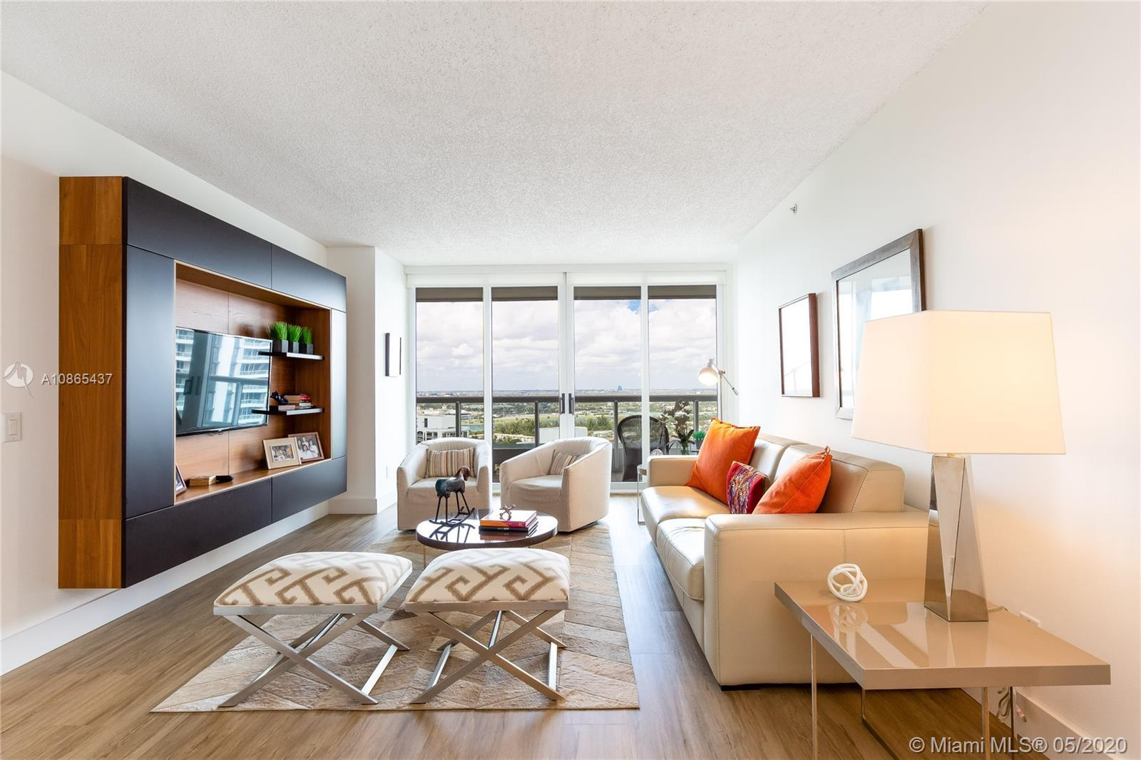 ENJOY GORGEOUS AND UNINTERRUPTED MARINA AND CITY VIEWS FROM YOUR BALCONY AND ONE OF A KIND SUNSETS I