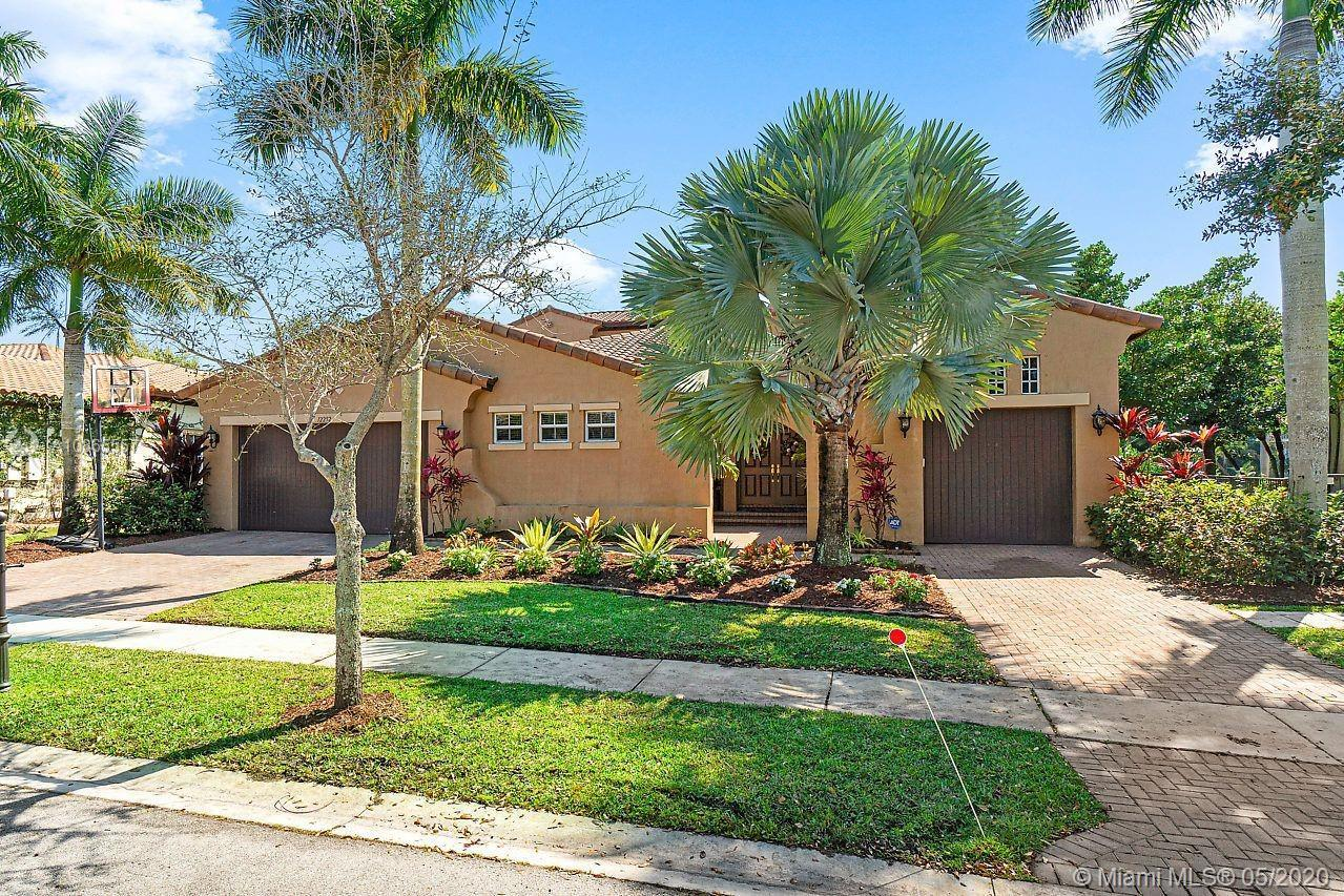 Spectacular waterfront home in prestigious Edgewood Heron Bay. Six (6) large bedrooms and five (5) f