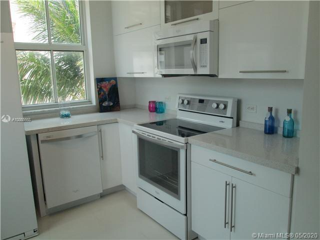 GREAT OPPORTUNITY TO OWN AN SPECTACULAR VACATION CORNER HOME 3/2 AT WAVERLY AT SURFSIDE ACROSS FROM