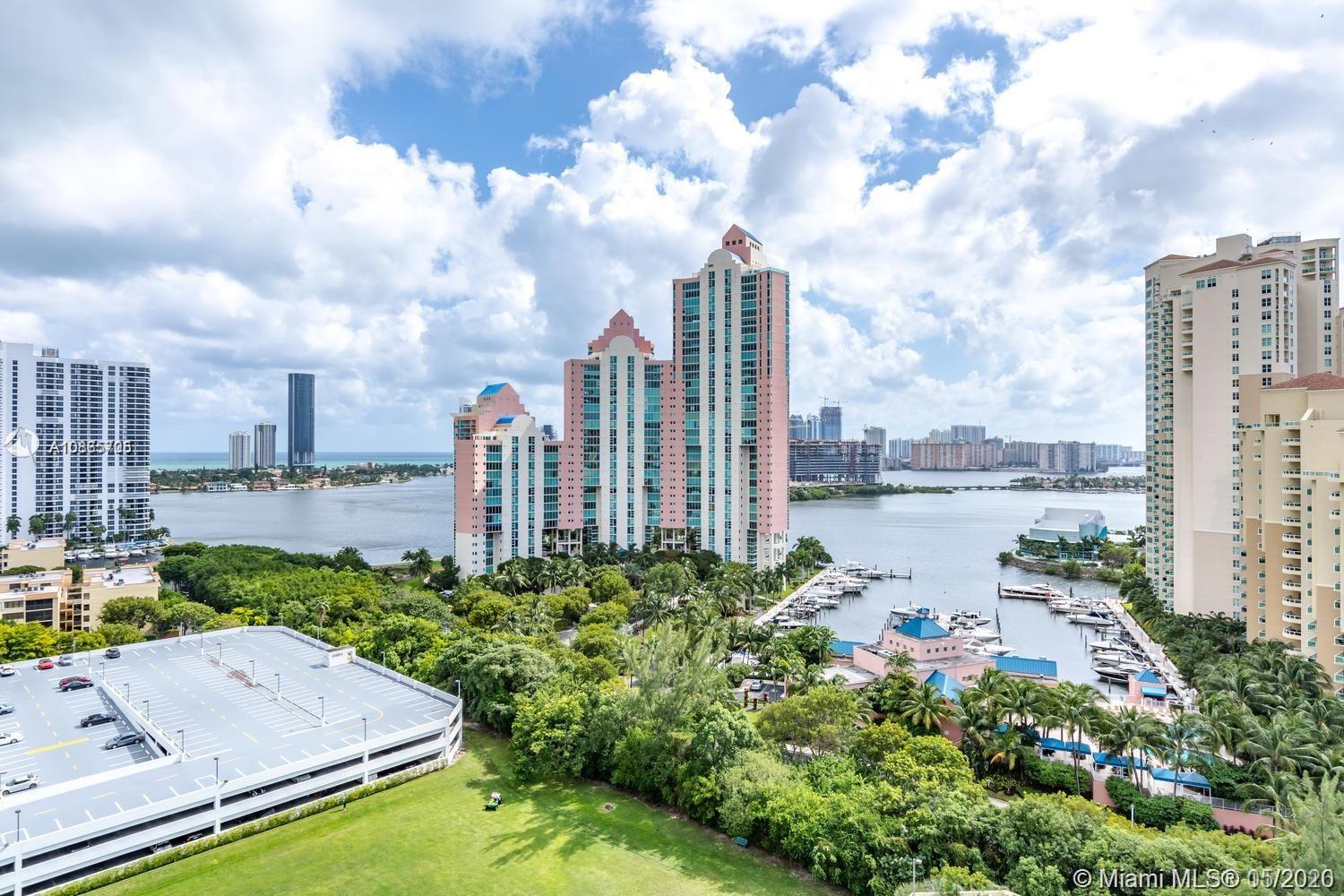 LARGEST 2 BEDROOM WITH DEN CORNER UNIT BOASTS 1300+ SQUARE FEET WITH 3 BALCONIES! BEAUTIFUL VIEWS OF