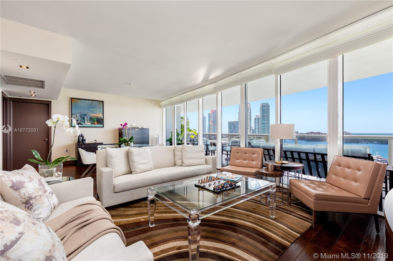 Panoramic bay views greet you as you enter this beautifully renovated apartment in the premier 06 li